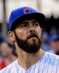 Aug 31, 2015; Chicago, IL, USA; Chicago Cubs starting pitcher Jake Arrieta (49) looks on during a ceremony before the game against the Cincinnati Reds at Wrigley Field. Arrieta pitched a no-hitter the night before in Los Angeles. Mandatory Credit: Matt Marton-USA TODAY Sports