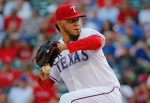 Texas Rangers pitcher Yovani Gallardo throws a first inning pitch during the Los Angeles Dodgers vs. the Texas Rangers major league baseball game at Globe Life Park in Arlington, Texas, on Monday, June 15, 2015. (Louis DeLuca/The Dallas Morning News)